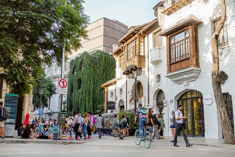 People walking by in Barrio Lastarria